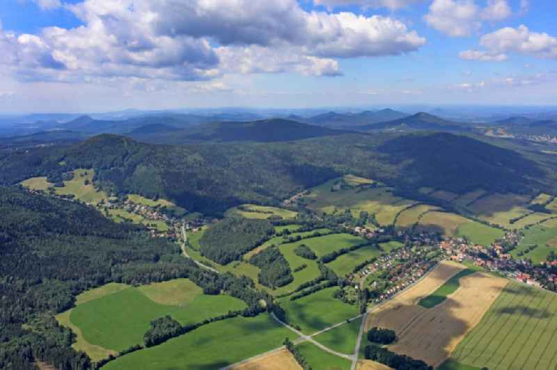 Agricultural land and field borders surround the settlement area of the village in Waltersdorf in the state Saxony, Germany