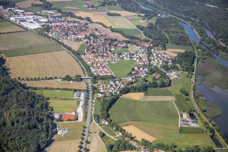 Local view with streets and houses on the bank area of a??a??the Mittlere-Isar Canal in Weixerau in the state Bavaria, Germany