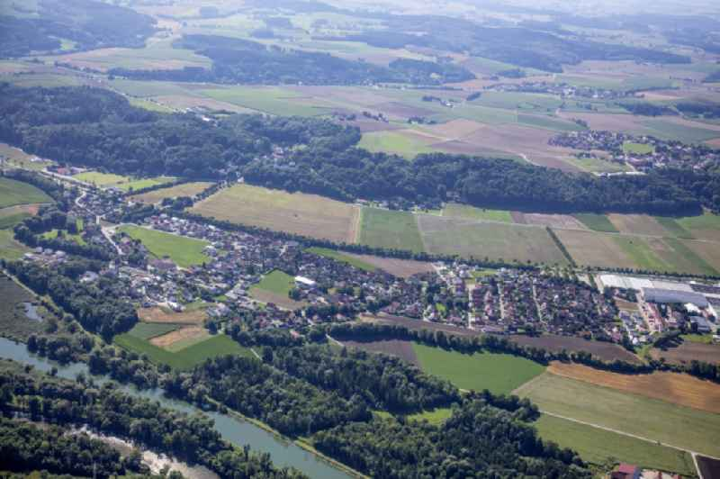 Local view with streets and houses on the bank area of a??a??the Mittlere-Isar Canal and surrounded by agricultural fields in Weixerau in the state Bavaria, Germany