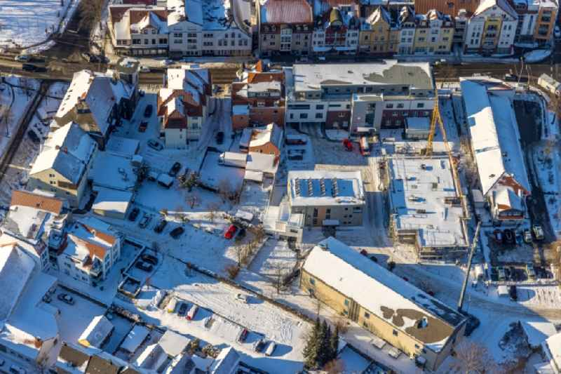 Wintry snowy construction site of the new buildings of the retirement home - retirement ' Caritas Sozialstation Werl ' on street Bahnhofstrasse in Werl in the state North Rhine-Westphalia, Germany