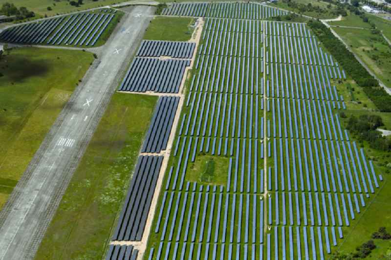 Panel rows of photovoltaic and solar farm or solar power plant in Werneuchen in the state Brandenburg