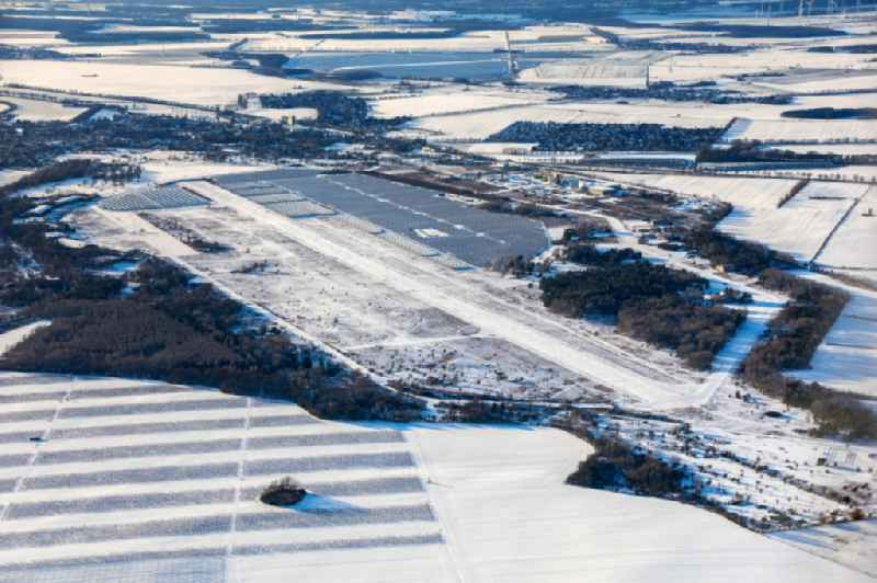 Wintry snowy runway with tarmac terrain of airfield in Werneuchen in the state Brandenburg, Germany