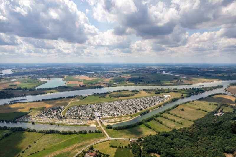Camping with caravans and tents on Rhone river in Wesel in the state North Rhine-Westphalia, Germany. Further information at: Grav-insel GmbH & Co KG.