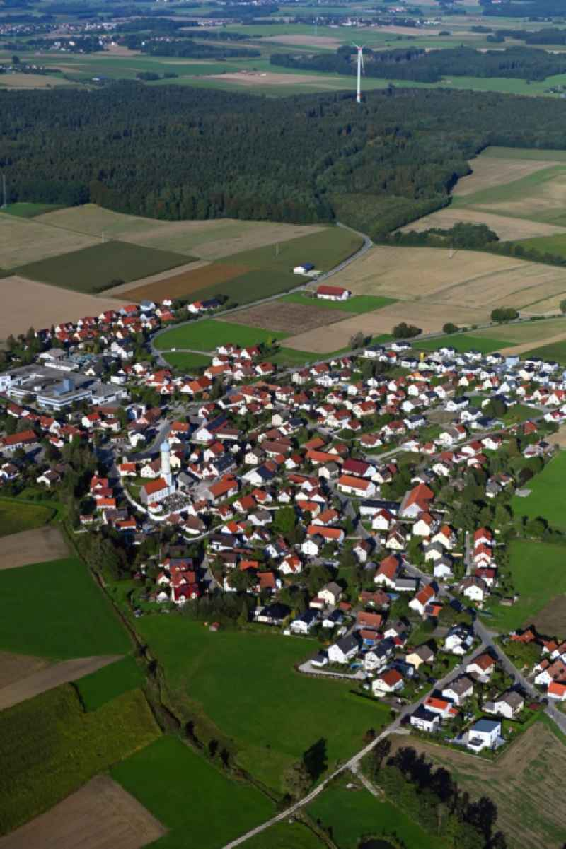 Village view on the edge of agricultural fields and land in Wiedenzhausen in the state Bavaria, Germany