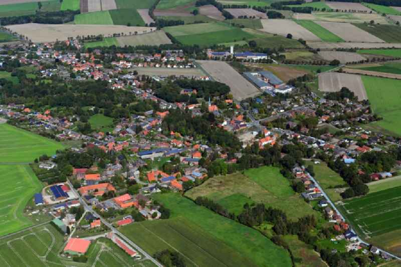 Village view on the edge of agricultural fields and land in Wieren in the state Lower Saxony, Germany