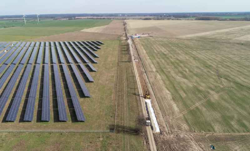 Construction site and assembly work for solar park and solar power plant ' Solarpark Weesow-Willmersdorf ' in Willmersdorf in the state Brandenburg, Germany