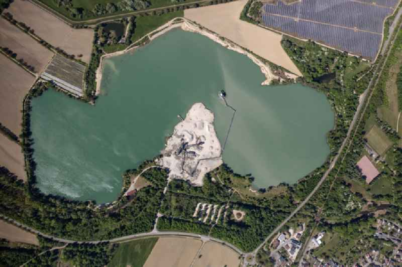 Lake shore and overburden areas of the quarry lake and gravel open pit in Wintersdorf in the state Baden-Wuerttemberg, Germany