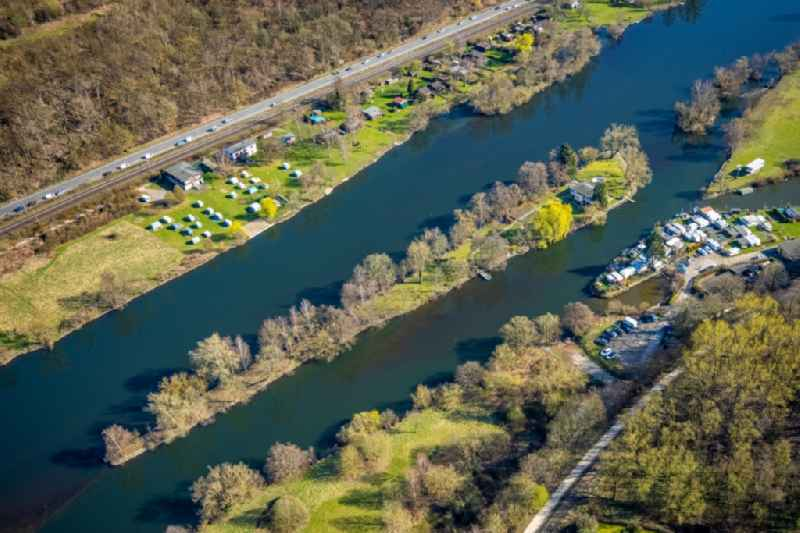 Island on the banks of the river course of Ruhr overlooking a campsite in the district Bommern in Witten at Ruhrgebiet in the state North Rhine-Westphalia, Germany