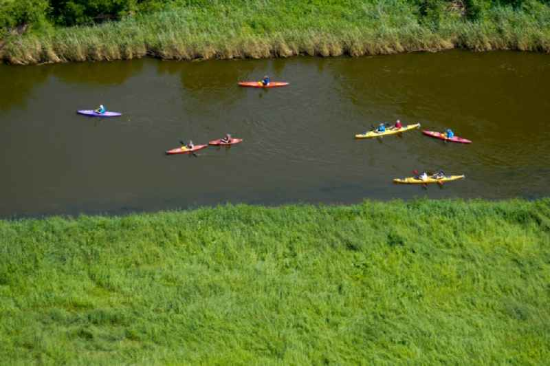 Canoeists - ride and training on river Werra in Witzenhausen in the state Hesse, Germany