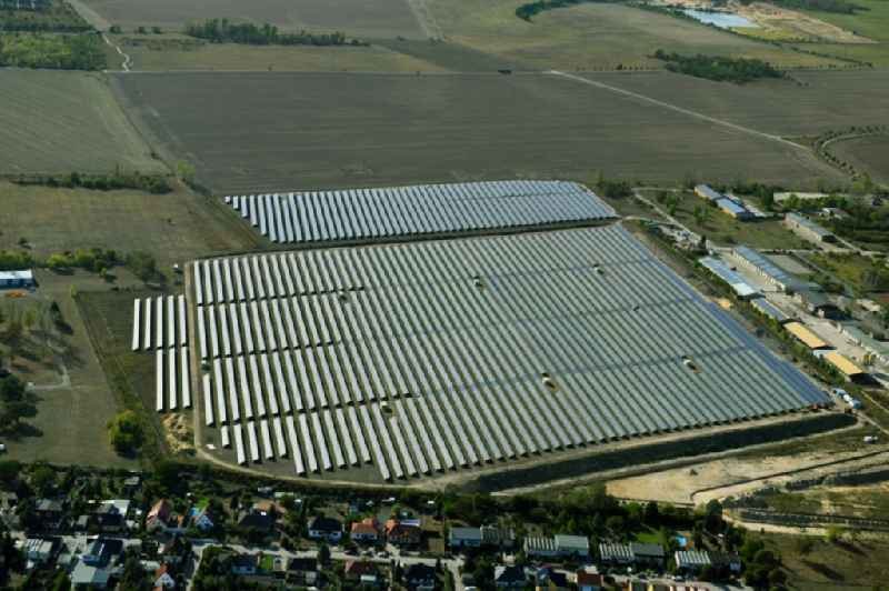 Panel rows of photovoltaic and solar farm or solar power plant in Wolfen in the state Saxony-Anhalt, Germany