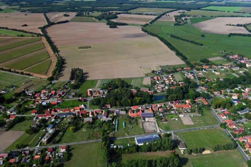 Agricultural land and field borders surround the settlement area of the village in Zaatzke in the state Brandenburg, Germany