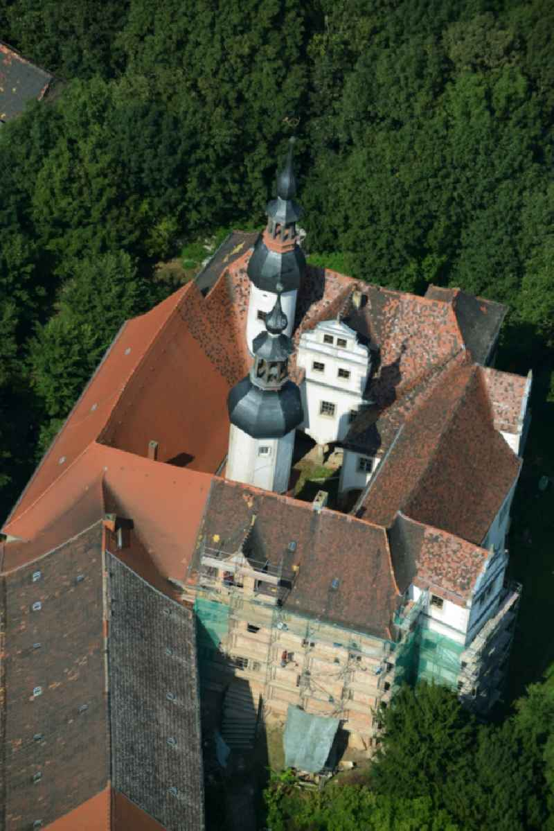 Building and Park of Castle Zschepplin in Zschepplin in the state of Saxony. The castle with its church, yard and towers is located in a forest on the edge of Zschepplin