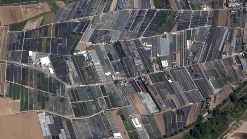Rows of greenhouses for growing plants in the district Volmerswerth in Duesseldorf in the state North Rhine-Westphalia, Germany