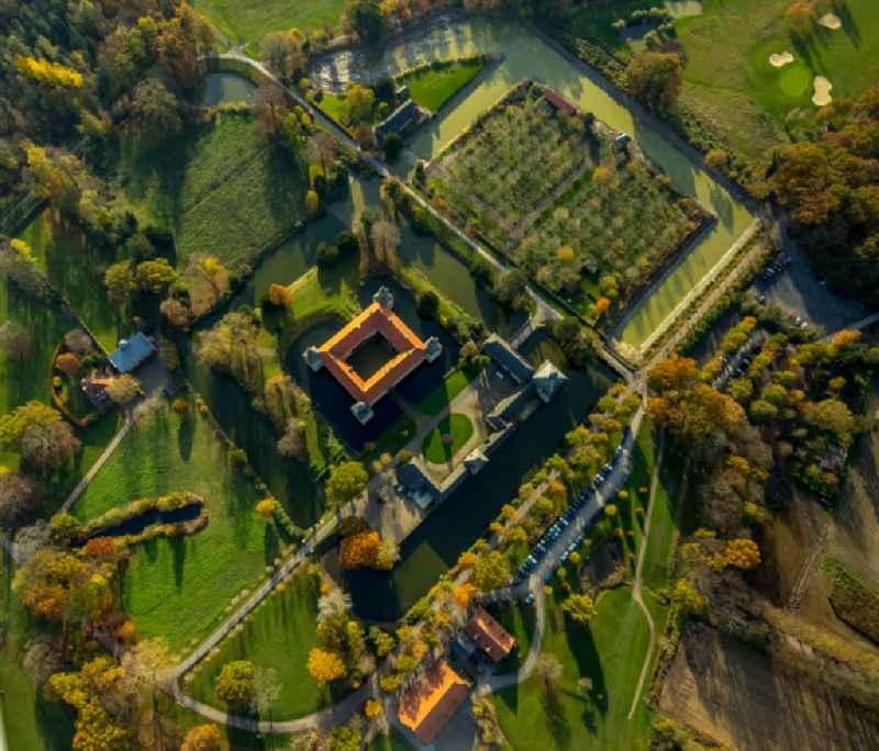 Vertical aerial view from the satellite perspective of the building and castle park systems of water castle Westerwinkel in Ascheberg in the state North Rhine-Westphalia, Germany