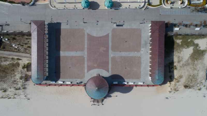 Vertical aerial view from the satellite perspective of the ensemble space an place Kurplatz on Strandpromenade in the inner city center in Binz in the state Mecklenburg - Western Pomerania, Germany
