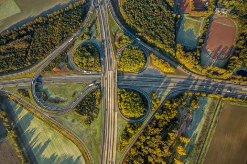 Vertical aerial view from the satellite perspective of the traffic flow at the intersection- motorway A52 - 44 ' Kreuz Neersen ' in form of cloverleaf in Cloerbruch in the state North Rhine-Westphalia, Germany.