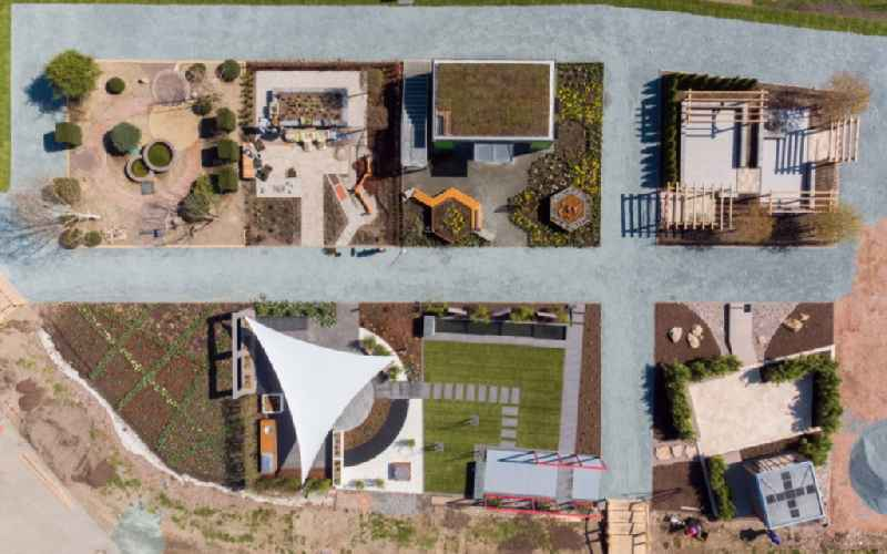 Vertical aerial view from the satellite perspective of the building site for the construction and layout of a new park with paths and green areas in Frankenberg/Sa. in the state Saxony, Germany
