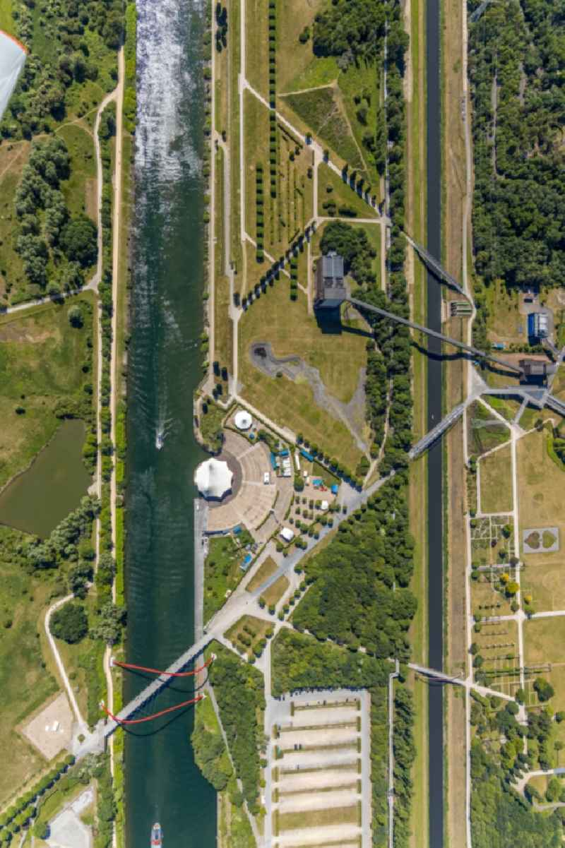 Vertical aerial view from the satellite perspective of the construction of the building of the open-air theater Amphitheater-Gelsenkirchen on Grothusstrasse on shore of river Rhein-Herne-Kanal in the district Horst in Gelsenkirchen in the state North Rhine-Westphalia, Germany