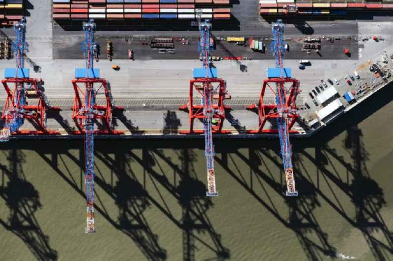 Vertical aerial view from the satellite perspective harbor crane of the container Terminal in the port of the international port of the EUROGATE Container Terminal Hamburg GmbH in Hamburg