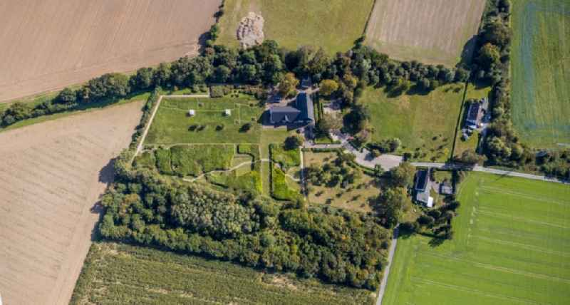 Vertical aerial view from the satellite perspective of the homestead of a farm of 'Emscherquellhof' on Quellenstrasse in the district Aplerbeck in Holzwickede in the state North Rhine-Westphalia, Germany