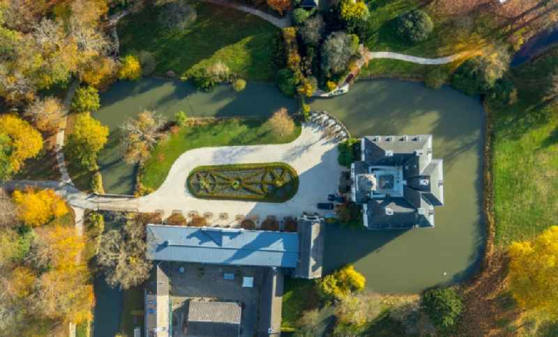 Vertical aerial view from the satellite perspective of the building and castle park systems of water, castle Gartrop in Huenxe in the state North Rhine-Westphalia, Germany
