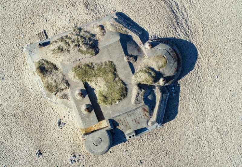 Vertical aerial view from the satellite perspective of the bunker building complex made of concrete and steel on the sandy beach of the North Sea in Klitmoller in Nordjylland, Denmark