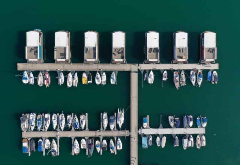 Vertical aerial view from the satellite perspective of the pleasure boat marina with docks and moorings on the shore area of Geiseltalsee of Marina Muecheln GmbH on Hafenplatz in Muecheln (Geiseltal) in the state Saxony-Anhalt, Germany