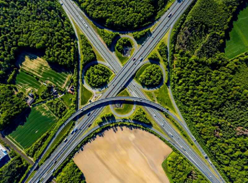 Vertical aerial view from the satellite perspective of the traffic flow at the intersection- motorway A 43 - A1 'Kreuz Muenster-Sued' in Muenster in the state North Rhine-Westphalia, Germany