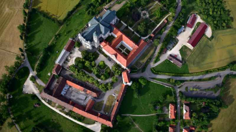 Vertical aerial view from the satellite perspective of the complex of buildings of the monastery Abtei Benediktinerkloster  in Neresheim in the state Baden-Wuerttemberg, Germany