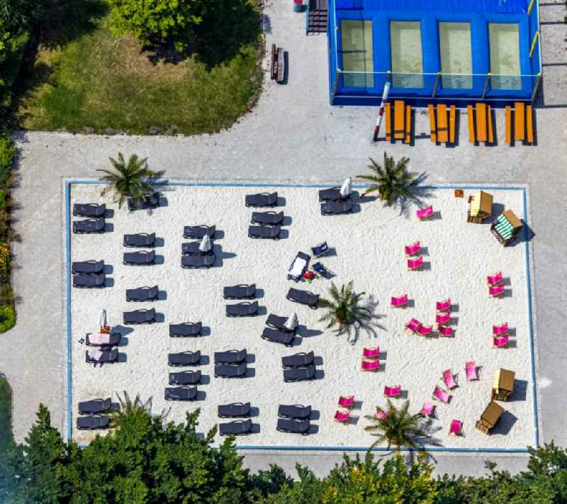 Vertical aerial view from the satellite perspective of the bathers on the sandy areas by the pool of the swimming pool in Soest in the state North Rhine-Westphalia, Germany